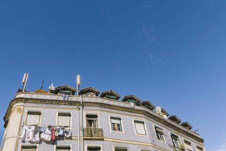 Lisbon facade with windows and typical portuguese tiles on the wall, picturesque lisbon architecture, copy space for text
