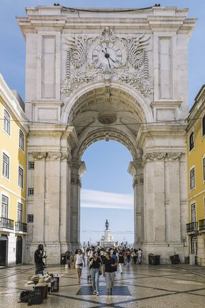 Lisbon, Portugal august, 2019: vertical photo of Augusta Arch Street on Commerce Square with tourists walking down the cobblestone street