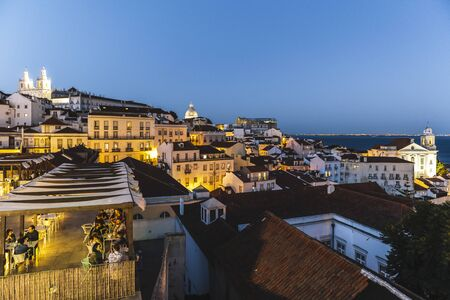 Lisbon, Portugal? august, 2019: View of the Alfama neighborhood from the Portas do Sol viewpoint at night Фото со стока