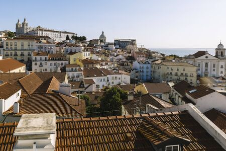 View of the Alfama neighborhood from the Portas do Sol viewpoint at morning in Lisbon. Travel and tourism in Portugal concept