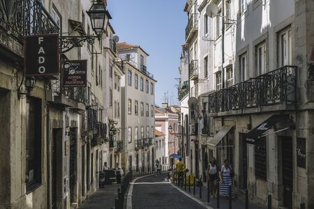 Lisbon, Portugal ? ?? august, 2019: Rua dos Remedios is a typical portuguese cobblestone street in Lisbon with venues to listen Fado Banco de Imagens