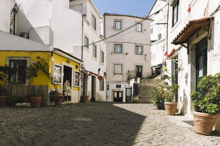 typical traditional portuguese cobblestone street in Lisbon, Portugal