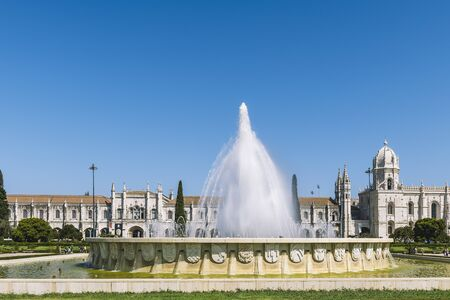 fountain in front of the Jeronimos Monastery or Hieronymites Monastery, a UNESCO world heritage site in Belem district at Lisbon. Travel and tourism concept in Portugal