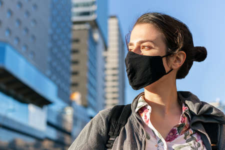 portrait of a young girl wearing a protective mask, concept of active lifestyle, protection against covid and sustainable mobility Archivio Fotografico