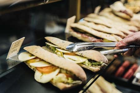 vegan sandwich held by a hand