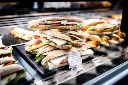 Assortment of cheese sandwiches in the display window of a food store Stockfoto