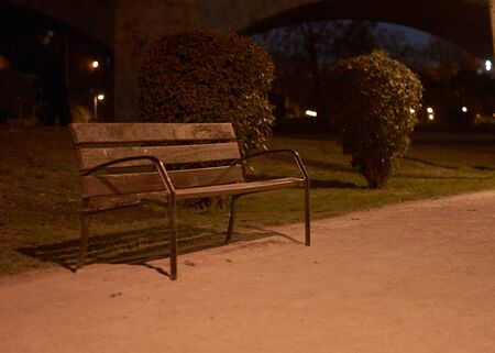 Lonely bench in the dark waiting for a friend.Loneliness and tranquility