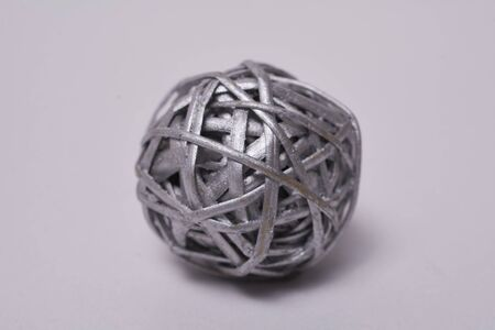 Macro photography of ball made of silver painted straw, closeup and detail of straw Banco de Imagens