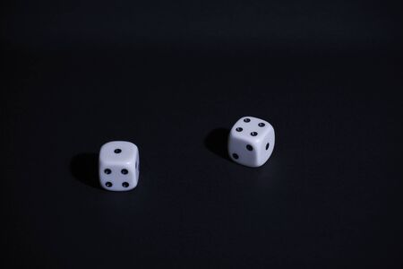 Two dice on black background, Static, horizontal