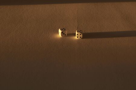 Two dice on a golden background, static