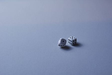 Two dice in motion, on white background, long exposure Stock Photo