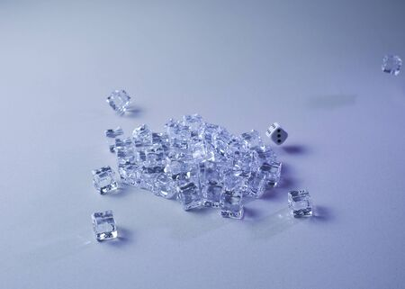 Set of ice cubes and dice falling on them, gray background, chaos 免版税图像