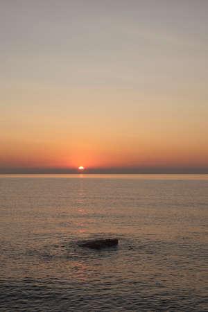 Sunrise on the rocky beach, Orange colors, lonely 版權商用圖片