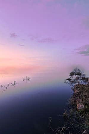 Infinite lake shore, no horizon, vegetation, sunset, colors