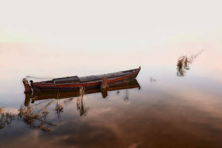 Small fishing boat on the lake, no horizon, high key