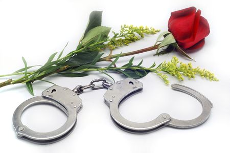 Handcuffs and Rose in white background.
