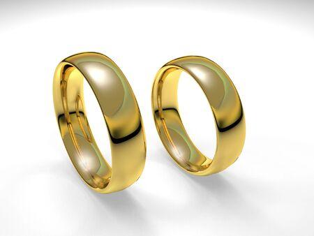 Paire d'anneaux d'or de mariage rendue en 3D isolé en arrière-plan blanc. Banque d'images - 3518950