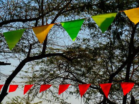 triangle shape: craft fair tree art installation of triangle shape colorful cone