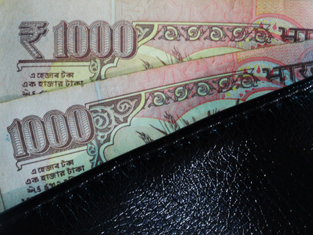 third world economy: Two Thousand Rupees Notes in Black Leather Wallet, India Stock Photo