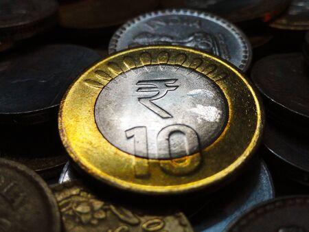 coins shot in golden color: Ten and Five Rupees Indian Silver Gold Coin