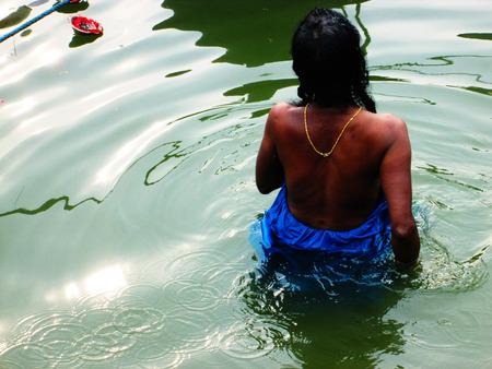 taking bath: Woman taking bath in holy Ganga, India