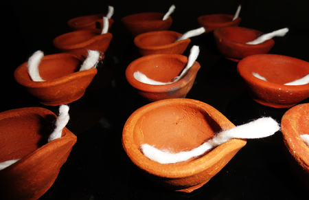 red oil lamp: Traditional Clay Diyas during Diwali Celebration in India Stock Photo
