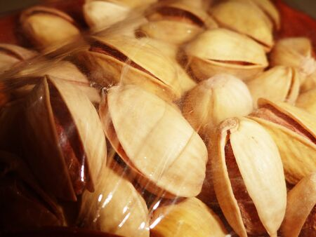pista: Macro Shot of Fresh Pistachio wrapped with foil sheet Stock Photo