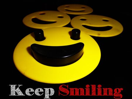 react: Smilies and Keep Smiling message on Black Background