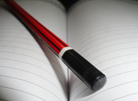 habbit: Macro Shot of Pencil Lying on Diary Page