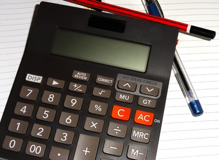 habbit: Ball Pen, Pencil, Calculator Lying on Diary Page