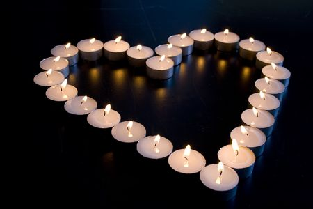steadily: Group of Candles place in the shape of a heart Stock Photo