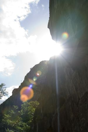 cliff face: Beautiful view from the bottom of a cliff face in somerset uk with bright lens flare