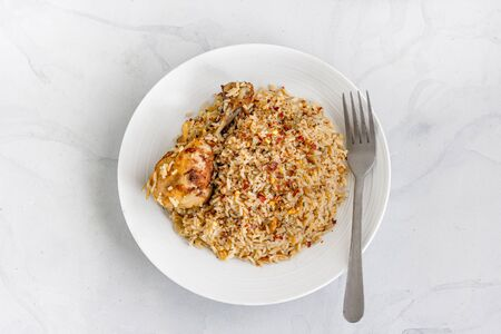 One Pot Greek Mediterranean Chicken and Rice Flat Lay Top Down Photo on White Background