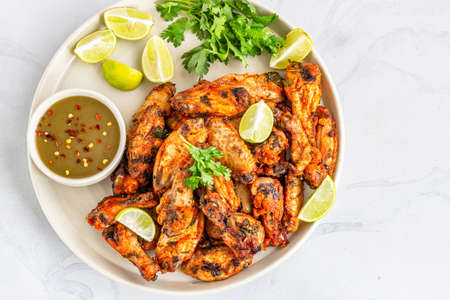 Baked Cilantro Lime Chicken Wings with Fresh Lime and Cilantro Top Down Photo
