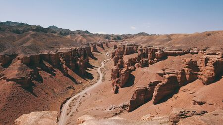 Charyn canyon is the younger brother of the Grand canyon in the United States. Located in Kazakhstan. Visible layers of earth rock, huge crevices, hills and a degree. Red color of breed. Like Mars.