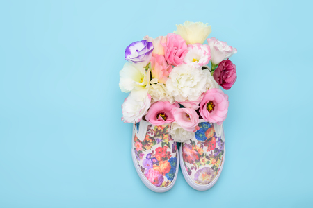 doubling: Beautiful gumshoes with flowers inside on bright background Stock Photo