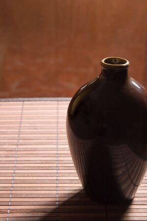 Pretty ceramic jug on a bamboo napkin photo