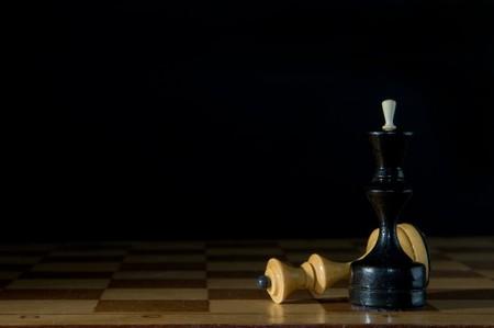 chessmen: Two chessmen on a chessboard, black background