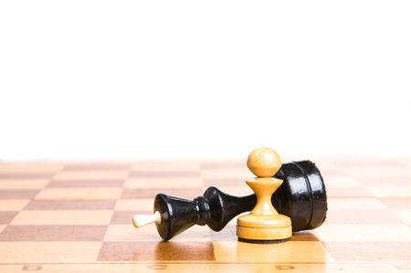 chessmen: Two chessmen on a chessboard, white background