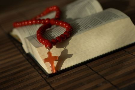 minister: Book and red beads with cross Stock Photo