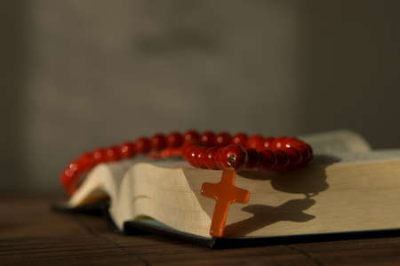 sermon: Book and red beads with cross Stock Photo