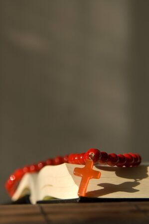 psalm: Book and red beads with cross Stock Photo