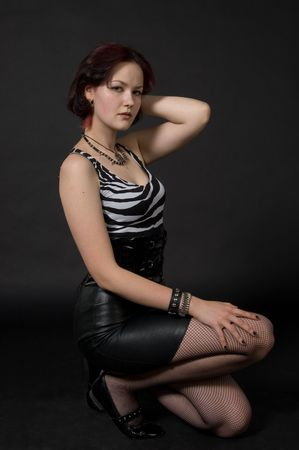 leather skirt: Young woman in leather skirt