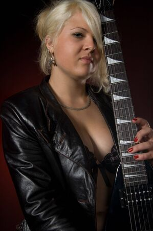 Young woman with electric guitar photo