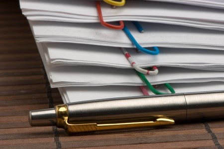 paper clip: Many paper sheets, documents with many-coloured clips and pen Stock Photo