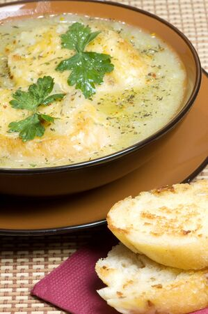 French leek soup with toast and cheese photo
