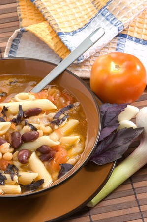 Soup with beans and macaroni, italian dish photo