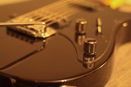 A close look at a guitar with a vintage vibe.