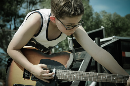 My son, when he was 11, playing the National Anthem and other tunes for the 2016 Pizzas Run Car Show at Soda Springs City Park...an annual event displaying classic cars from all over the United States.