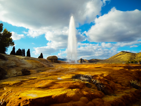 The Soda Springs Geyser against a cloudy blue sky. Reklamní fotografie